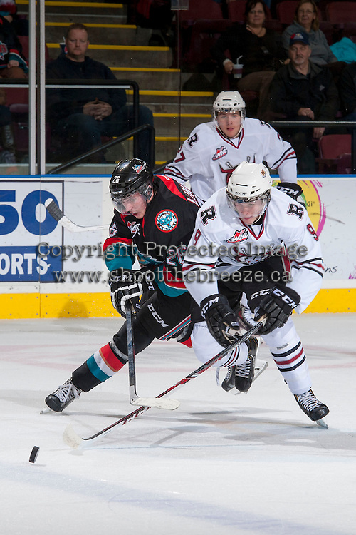 KELOWNA, CANADA - NOVEMBER 6: Cole Linaker #26 of the Kelowna Rockets checks Connor Bleackley #9 of the Red Deer Rebels on NOVEMBER 6, 2013 at Prospera Place in Kelowna, British Columbia, Canada.   (Photo by Marissa Baecker/Shoot the Breeze)  ***  Local Caption  ***
