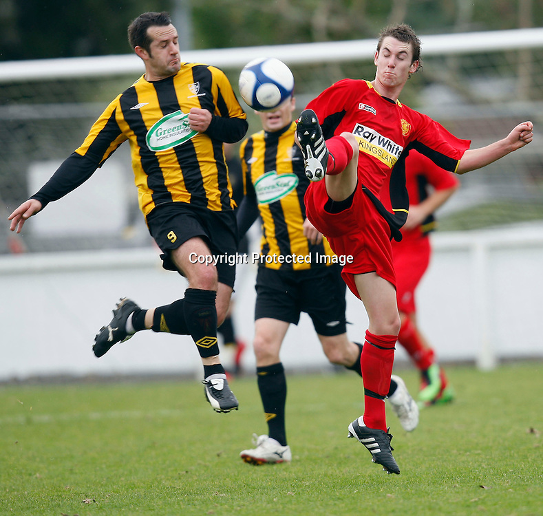 Ellerslie's Scott Wallace gets a foot to the ball ahead of Glenfield's Graham Greene. Football, Chatham Cup 3rd Round, Glenfield Rovers v Ellerslie AFC, McFetridge Park Glenfield, Saturday 19th June 2010. Photo: Shane Wenzlick/PHOTOSPORT