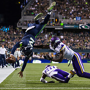 Seattle Seahawks quarterback Trevor Boykin #2 leaps over Minnesota Vikings safety Jayron Kearse #27 during the NFL preseason week 2 game on Thursday, Aug. 18, 2016 in Seattle. The Vikings won, 18-11. (Ric Tapia via AP)