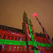 The Brussels Town Hall (Hotel De Ville) dominates the Grand place by day, and also during christmas time by night, wrapped in light here as a present