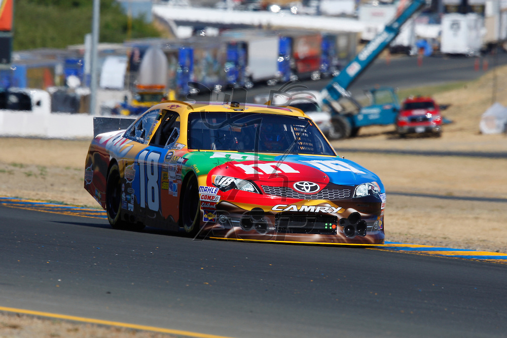 SONOMA, CA - JUN 22, 2012:  Kyle Busch (18) brings his car through turn 10 during a practice session for the Toyota Save Mart 350 at the Raceway at Sonoma in Sonoma, CA.