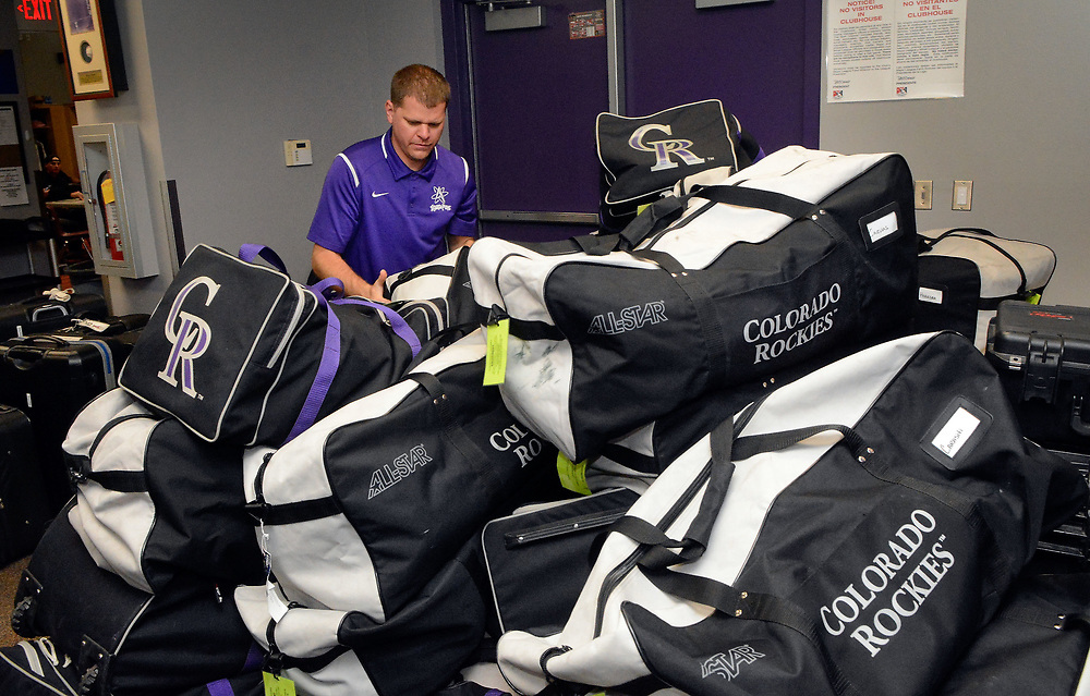 jt060817g/ sports/jim thompson/ Isotopes' clubhouse manager Ryan Maxwell packs a bag for a player as they get the team ready for a road trip to Salt Lake City. Albuquerque  Thursday June. 08, 2017. (Jim Thompson/Albuquerque Journal)