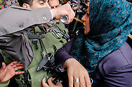 A Israeli policeman spary pepper spray on a Palestinian woman`s face in Damascus Gate Jerusalem during Land Day demonstration. March 30, 2013.  Photo by Oren Nahshon