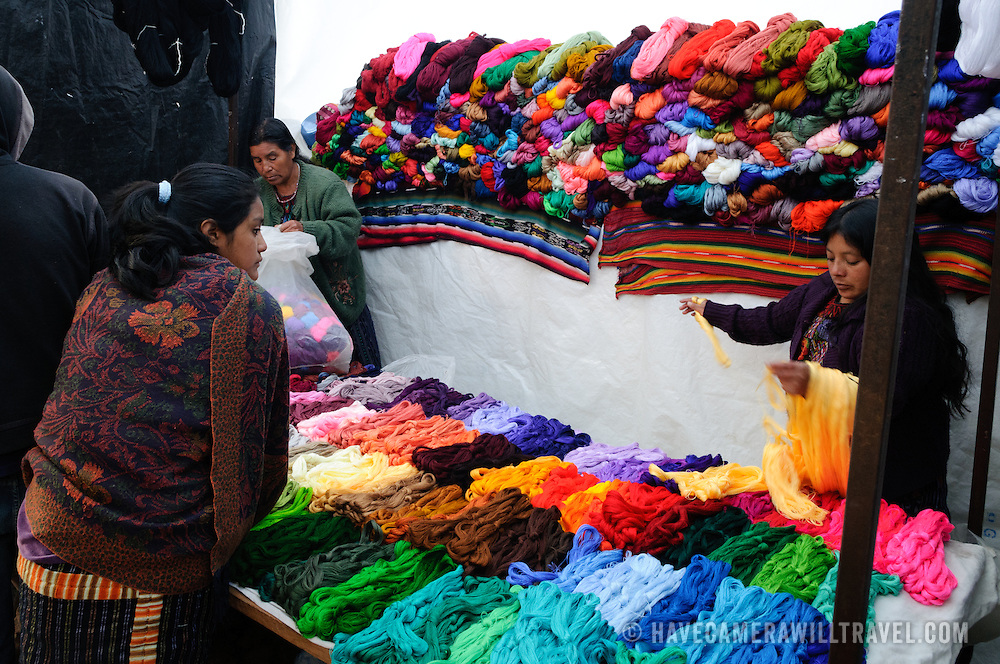 Colorful threads for weaving available for sale at the Sunday market. Chichicastenango is an indigenous Maya town in the Guatemalan highlands about 90 miles northwest of Guatemala City and at an elevation of nearly 6,500 feet. It is most famous for its markets on Sundays and Thursdays.
