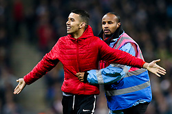A pitch invader is escorted off the field by a steward - Mandatory by-line: Robbie Stephenson/JMP - 15/11/2018 - FOOTBALL - Wembley Stadium - London, England - England v United States of America - International Friendly