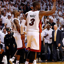 Jun 18, 2013; Miami, FL, USA; Miami Heat shooting guard Dwyane Wade (3) and center Chris Bosh (1) celebrate defeating the San Antonio Spurs at the end of game six in the 2013 NBA Finals at American Airlines Arena. The Heat won 103-100 in overtime. Mandatory Credit: Derick E. Hingle-USA TODAY Sports