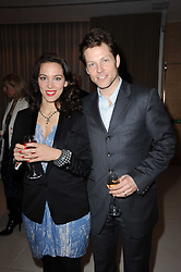 JAMIE BAMBER and his wife KERRY NORTON at a party to celebrate Lancome's 10th anniversary of sponsorship of the BAFTA's in association with Harper's Bazaar magazine held at St.Martin's Lane Hotel, London on 19th February 2010.