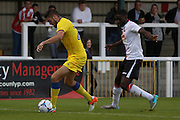 AFC Wimbledon defender Ryan Sweeney (20) shields the ball from Woking midfielder Brian Saah during the Pre-Season Friendly match between Woking and AFC Wimbledon at the Kingfield Stadium, Woking, United Kingdom on 29 July 2016. Photo by Stuart Butcher.