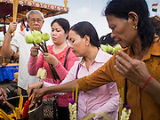 25 FEBRUARY 2015 - PHNOM PENH, CAMBODIA: People light incense and candles to pray with at a Buddhist shrine in Phnom Penh.    PHOTO BY JACK KURTZ