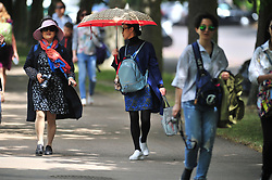 © Licensed to London News Pictures. 23/06/2017 <br /> Sun umbrella .<br /> Another sunny weather day in London and the South East.<br /> People enjoying the sunshine in Greenwich Park,Greenwich,London today.<br /> Photo credit: Grant Falvey/LNP