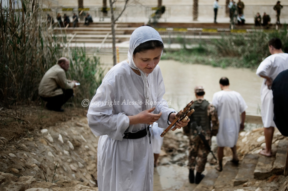 """JORDAN, BETHANY : An eastern European Christian Orthodox pilgrim stepping out from the waters of the Jordan river in Bethany on January 18, 2011, believed to be the biblical """"Bethany-beyond-the-Jordan"""", where John the Baptist lived and Jesus was baptized. ALESSIO ROMENZI"""
