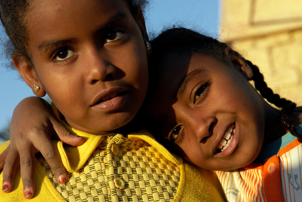 Egypt, Aswan. December/26/2008...Two girls from a Nubian household pose for a portrait on the banks of the Nile River.