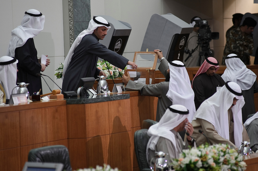 Member of Parliament Marzouq Al-Ghanem casts his vote for parliament speaker during the inaugural session of the new National Assembly Feb. 15, 2012 in Kuwait City. Kuwaitis voted Feb. 2 for a new 50-member National Assembly (parliament).