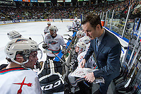 KELOWNA, CANADA - APRIL 4: Head coach Brad Ralph of the Kelowna Rockets goes over a play from the bench during a time out against the Kamloops Blazersof Kelowna Rockets on April 4, 2016 at Prospera Place in Kelowna, British Columbia, Canada.  (Photo by Marissa Baecker/Shoot the Breeze)  *** Local Caption *** Brad Ralph;