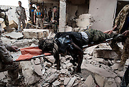 Libya, Sirte: The body of a fighter of the Libyan forces affiliated to the Tripoli government killed by ISIS suicide bomber is taken away from the frontline with ISIS in Al Jiza neighbourhood on November 26, 2016.  Alessio Romenzi