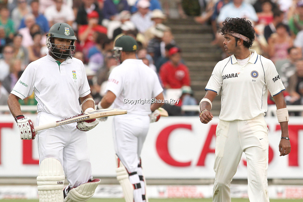 CAPE TOWN, SOUTH AFRICA - 2 January 2011, Sree Sreesanth of India glares at Hushim Amla of South Africa after being hit towards the boundary during day 1 of the 3rd Castle Test between South Africa and India held at Sahara Park Newlands Stadium in Cape Town, South Africa on the 2 January 2011 .Photo by: Shaun Roy