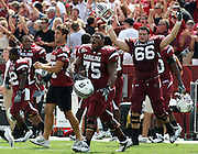 COLUMBIA - SEPTEMBER 11:  Members of the South Carolina Gamecocks team, including guard Steven Singleton #75 and tacklet Hutch Eckerson #66, run on the field after the game against the Georgia Bulldogs at Williams-Brice Stadium on September 11, 2010 in Columbia, South Carolina.  The Gamecocks beat the Bulldogs 17-6.  (Photo by Mike Zarrilli/Getty Images)