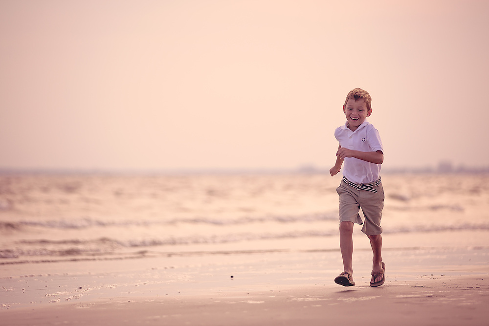 Images from a family beach portrait session with the Cain family at Sullivans Island and Fort Moultrie near Charleston and Mt. Pleasant, South Carolina.