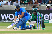 Rohit Sharma of India plays a sweep shot during the ICC Cricket World Cup 2019 match between Bangladesh and India at Edgbaston, Birmingham, United Kingdom on 2 July 2019.