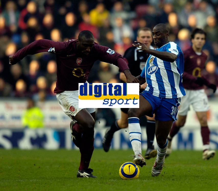 Photo: Jed Wee.<br />Wigan Athletic v Arsenal. The Barclays Premiership.<br />19/11/2005.<br />Wigan's Jason Roberts (R) takes on Arsenal's Sol Campbell.