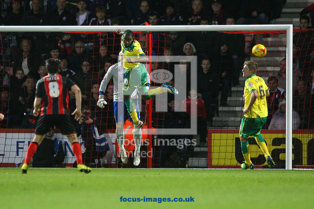 Cameron Jerome of Norwich heads clear during the match at the Goldsands Stadium, Bournemouth<br /> Picture by Paul Chesterton/Focus Images Ltd +44 7904 640267<br /> 10/01/2015