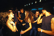 Happy looking dancers on the dance floor, UK 2000's