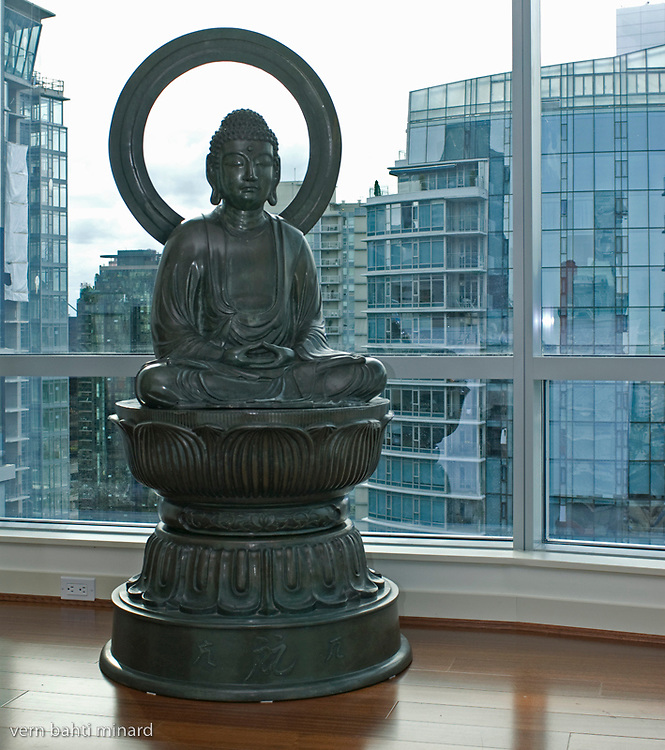 A antique brass buddha statue in a Coal Harbour condo.