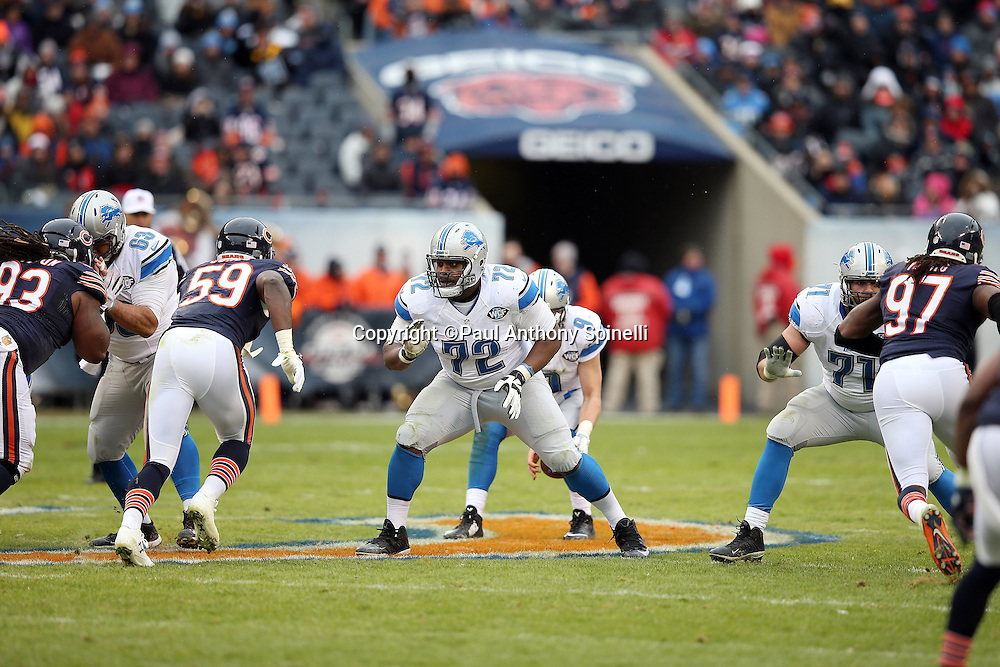Detroit Lions rookie offensive guard Laken Tomlinson (72) and Detroit Lions tackle Riley Reiff (71) block Chicago Bears inside linebacker Christian Jones (59) and Chicago Bears outside linebacker Willie Young (97) during the NFL week 17 regular season football game against the Chicago Bears on Sunday, Jan. 3, 2016 in Chicago. The Lions won the game 24-20. (©Paul Anthony Spinelli)