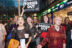 30/09/2017. Manchester, UK. The Commoners Choir of West Yorkshire give  a flash-mob welcome to Tory delegates arriving at Piccadilly Station in Manchester. Pro-peace, anti-austerity, anti-war protests, including rallies, public meetings, comedy, music, & culture, take place during the four days of the Conservative Party Conference in Manchester, UK. 1st - 4th Oct 2017. The protest festival has been organised by The People's Assembly. Photo credit: Graham M. Lawrence/LNP