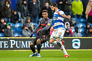 Stoke City forward Tyrese Campbell (26) tussles with Queens Park Rangers defender Yoann Barbet (29) during the EFL Sky Bet Championship match between Queens Park Rangers and Stoke City at the Kiyan Prince Foundation Stadium, London, England on 15 February 2020.