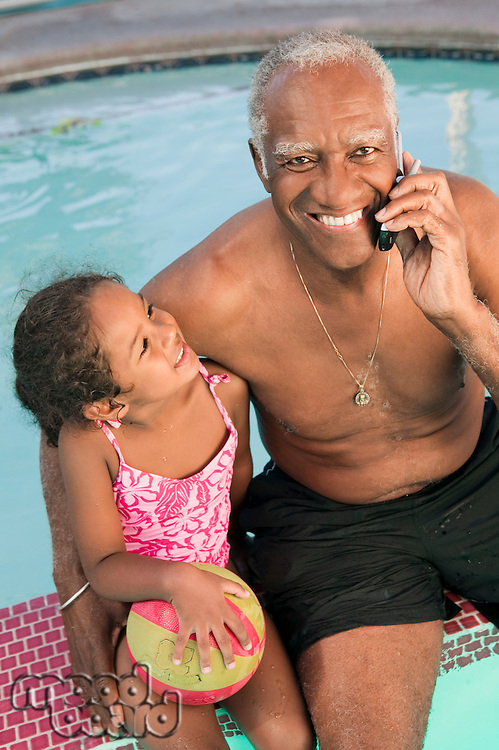 Grandfather and Granddaughter Playing by Pool