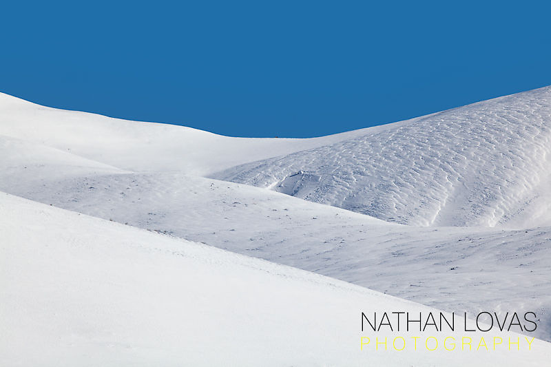 Snowy ridges with blue sky; Yellowstone NP.