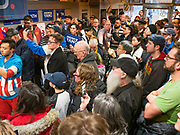 12 DECEMBER 2019 - DES MOINES, IOWA: People listen to Andrew Yang speak at the opening of his campaign office in Ames, IA. Yang, an entrepreneur, is running for the Democratic nomination for the US Presidency in 2020. He brought bus tour to Ames, IA, Thursday. Iowa hosts the the first election event of the presidential election cycle. The Iowa Caucuses will be on Feb. 3, 2020.      PHOTO BY JACK KURTZ