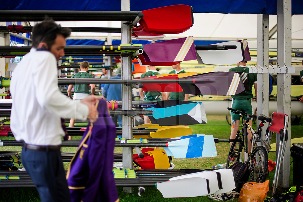 © Licensed to London News Pictures. 28/06/2017. London, UK. Oars covered in in rowing club colours at day one of the Henley Royal Regatta, set on the River Thames by the town of Henley-on-Thames in England.  Established in 1839, the five day international rowing event, raced over a course of 2,112 meters (1 mile 550 yards), is considered an important part of the English social season. Photo credit: Ben Cawthra/LNP