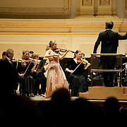 March 5, 2011 - Manhattan, NY : David Robertson, standing at right, and violinist Leila Josefowicz, standing at left, along with the St. Louis Symphony, perform Thomas Ades's 'Violin Concerto, 'Concentric Paths'' (2005) in the Isaac Stern Auditorium / Ronald O. Perelman Stage at Carnegie Hall on Saturday evening.  ////////// EDITOR: Virginia Avent. FOR DESK: CUL. PHOTO CREDIT: Karsten Moran for The New York Times