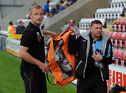 Bristol Rovers Steve Yates hands over the kit man duties to new kit man, Marco Carota - Mandatory byline: Neil Brookman/JMP - 07966 386802 - 03/10/2015 - FOOTBALL - Globe Arena - Morecambe, England - Morecambe FC v Bristol Rovers - Sky Bet League Two
