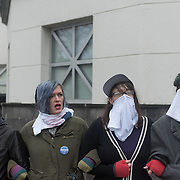 Protestors with the Black Lives Matter movement were told by activist organizers to prepare for the possible use of tear gas or other irritants by police during protests outside the Minneapolis Police Department 4th precinct headquarters, after activists who had been camped out in the front entrance to the precinct were cleared out on Wednesday, November 18, 2015 in Minneapolis, Minnesota. <br /> <br /> Protests and the encampment came in reaction to the shooting of 24-year-old Jamar Clark by Minneapolis Police on Sunday. <br /> <br /> <br /> Photo by Angela Jimenez for Minnesota Public Radio www.angelajimenezphotography.com