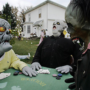 gouls - illinois, oct. 27 -- A farmyard in northwestern Illinois annually turns into a a goulish, Halloween delight for those traveling near Rock Falls.  A poker game turns scary for three of the over 200 characters that haunt the farmstead.