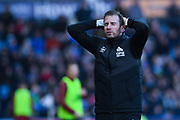 Jan Siewert of Huddersfield Town (Manager) has his hands on his head after a chance goes begging during the Premier League match between Huddersfield Town and Arsenal at the John Smiths Stadium, Huddersfield, England on 9 February 2019.