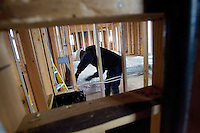 SAN RAMON, CA - DECEMBER 28:  A worker installs wiring on a new home development on December 28, 2007 in San Ramon, California. The Commerce Department reported December 28 that the sales of new homes in the US dropped to the lowest level in 12 years for the month of November.  (Photograph by David Paul Morris)