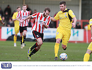James Dayton and Jack Holland during the Vanarama National League match between Cheltenham Town and Bromley at Whaddon Road, Cheltenham, England on 30 January 2016. Photo by Antony Thompson.