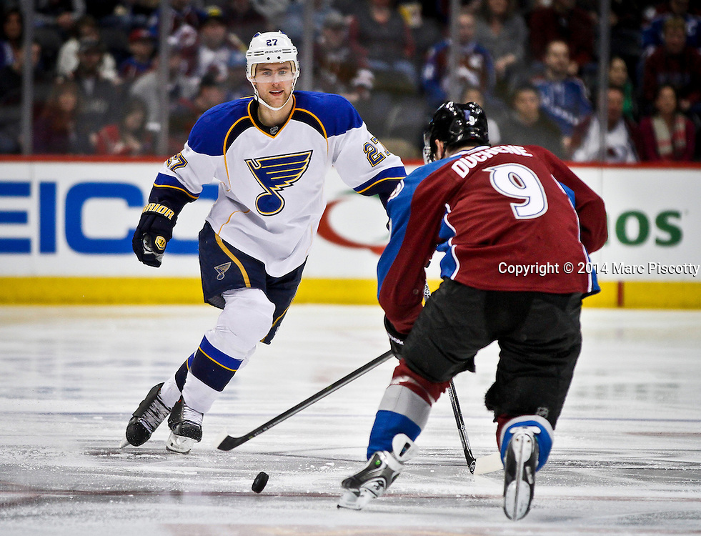 SHOT 3/8/14 3:58:29 PM - The St. Louis Blues' Alex Pietrangelo #27 plays defense against the Colorado Avalanche's Matt Duchene #9 during their regular season Western Conference game at the Pepsi Center in Denver, Co. The Blues won the game 2-1.<br /> (Photo by Marc Piscotty / &copy; 2014)