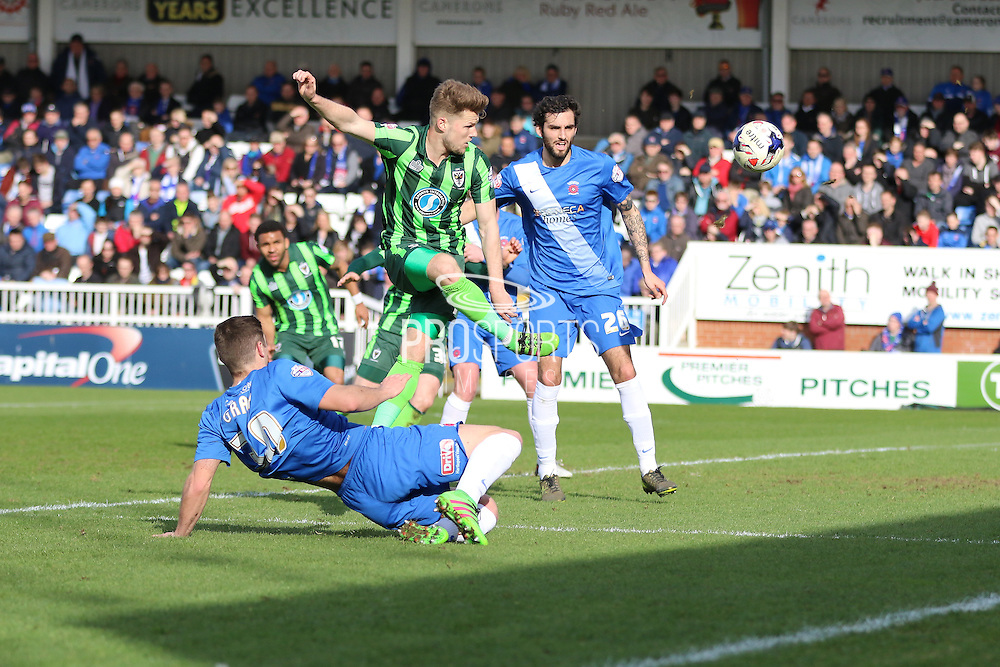 Jake Reeves midfielder for AFC Wimbledon (8) makes an attempt on goalduring the Sky Bet League 2 match between Hartlepool United and AFC Wimbledon at Victoria Park, Hartlepool, England on 25 March 2016. Photo by Stuart Butcher.