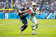 NASHVILLE, TN - DECEMBER 22:  Michael Thomas #13 of the New Orleans Saints stiff arms Logan Ryan #26 of the Tennessee Titans in the second half at Nissan Stadium on December 22, 2019 in Nashville, Tennessee. The Saints defeated the Titans 38-28.  (Photo by Wesley Hitt/Getty Images) *** Local Caption *** Michael Thomas; Logan Ryan