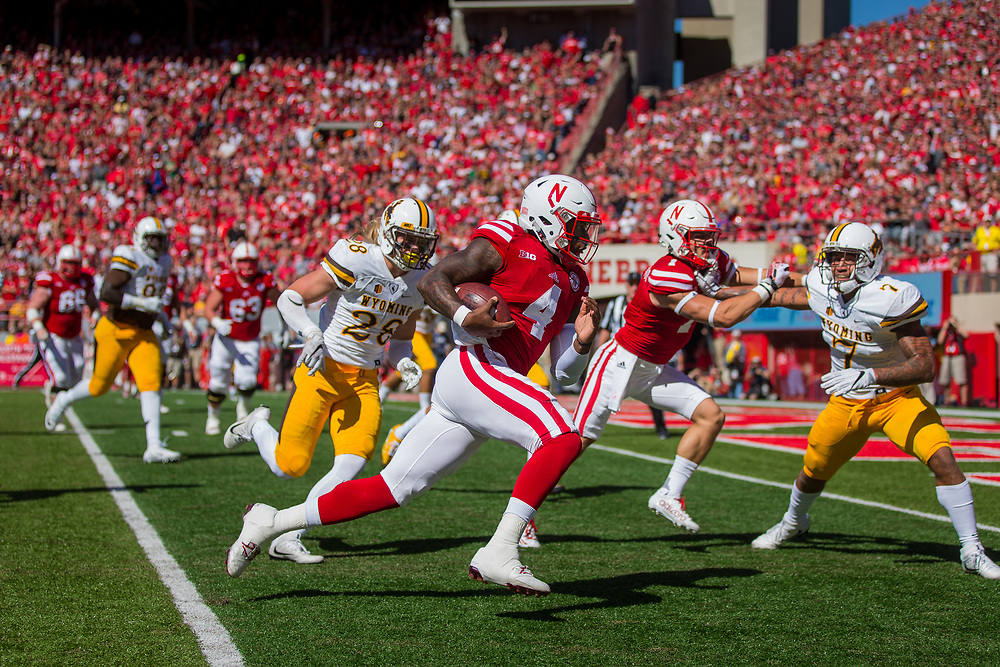 Tommy Armstrong Jr. #4 of the Nebraska Cornhuskers rushes for a touchdown during Nebraska's game against Wyoming at Memorial Stadium in Lincoln, Neb. on Sept. 10, 2016. Photo by Aaron Babcock, Hail Varsity