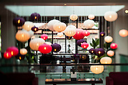 Multi-colored hanging lanterns fill the dining room at the Fusion Maia resort in Danang, Vietnam, Southeast Asia