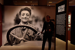 "© Licensed to London News Pictures. 14/11/2017. London, UK.  A large photograph of Enzo Ferrari greets visitors to the exhibition.  Preview of ""Ferrari: Under the Skin"", an exhibition at the Design Museum to mark the 70th anniversary of Ferrari.  Over GBP140m worth of Ferraris are on display from private collections including Michael Schumacher's 2000 F1 winning car.  The exhibition runs 15 November to 15 April 2018.  Photo credit: Stephen Chung/LNP"