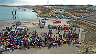 Evacuees gather at Marsh Harbour Port in Abaco on Friday, September 6, 2019 aas they await to leave the island after Hurricane Dorian swept through the Bahamas.