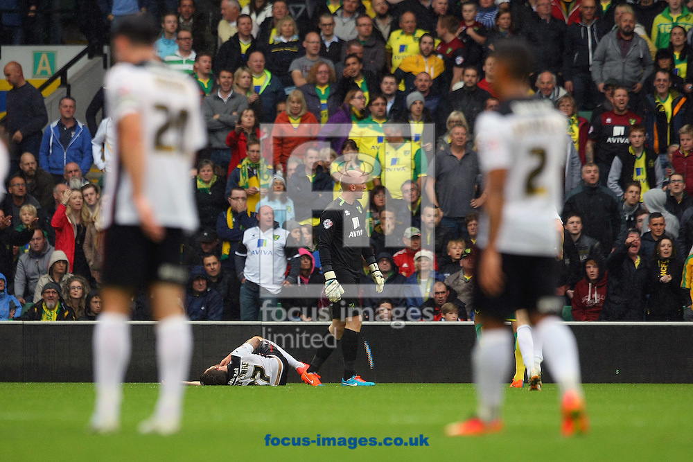 John Ruddy of Norwich waits to see his fate after bringing down Matt Derbyshire of Rotherham United in the box during the Sky Bet Championship match at Carrow Road, Norwich<br /> Picture by Paul Chesterton/Focus Images Ltd +44 7904 640267<br /> 04/10/2014