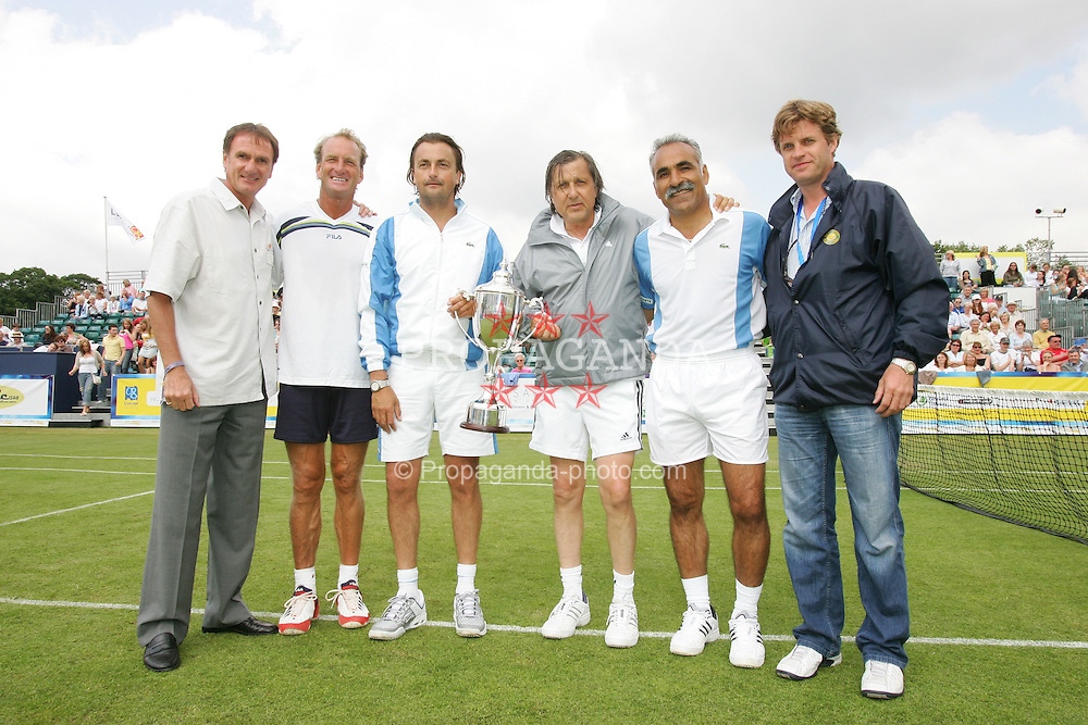 LIVERPOOL, ENGLAND - FRIDAY, JUNE 10th, 2005:  Liverpool FC Legend Phil Thompson with L-R Peter McNamara, Henri Leconte, Ilie Nastase, Mansour Bahrami and tournament Director Anders Borg after the Legends Doubles at the Liverbird Developments Liverpool International Tennis Tournament in Calderstones Park. (Pic by Dave Rawcliffe/Propaganda)